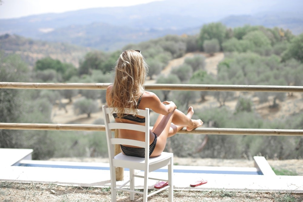 A woman sitting looking at the view