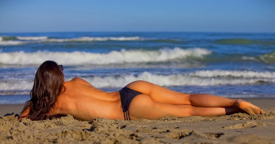 A girl tanning on the beach